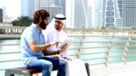 Dubai - Young people using digital tablet in the city video
