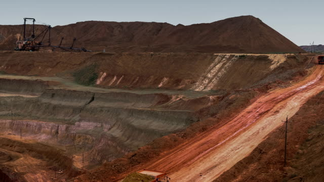 Dump truck carries ore from the quarry. Panorama of the mine. Barkhan sands. Development of minerals. video