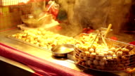 Dumplings grilling at vendor in Taiwanese Night Market video