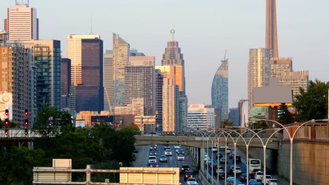 Dusk view by expressway of Toronto city center 4K video