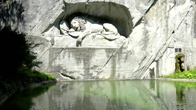 LUCERNE, SWITZERLAND - JULY 04, 2017: Dying Lion monument of Lucerne. It was carved on the cliff to honor the Swiss Guards of Louis XVI of France. video
