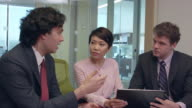 Dynamic Footage of Multi-Ethnic Business People in a Meeting - b video