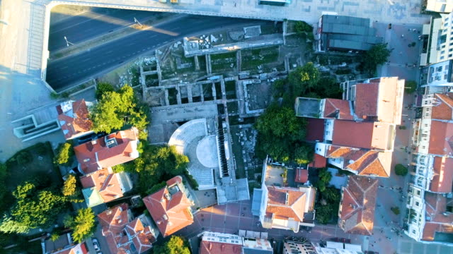Eagle eye view descending drone shot over ancient roman remains in the city of Plovdiv video