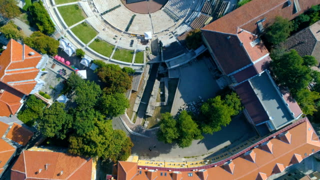 Eagle eye view drone shot of an ancient roman amphitheater in the city of Plovdiv in Bulgaria video