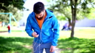 Early 30's bearded man running in park. video