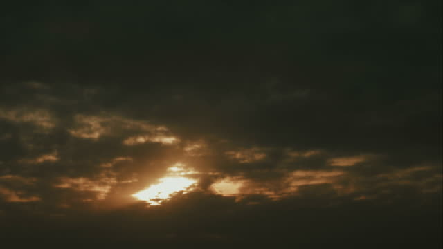 Early dark cold morning sunrise with cloudy sky time lapse video
