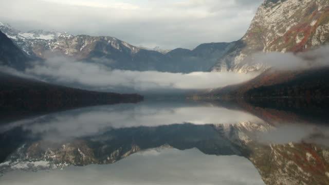 early morning mountain lake panning time-lapse video