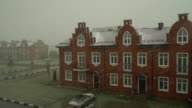 Early snow on red brick town houses video