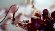 earrings with big red stones on spinning stand video