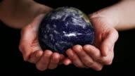 Earth Growing in Hands video