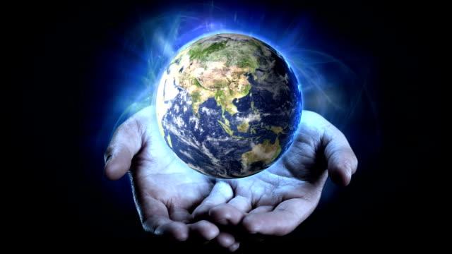 Earth in Hands. video