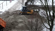 Earth mover pushing sand video