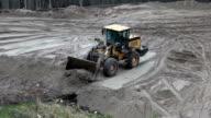Earthmover pushing sand video
