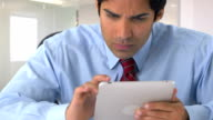 East Indian businessman working on tablet video