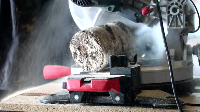 Eastern Europe: Lifestyle. Man sawing wood on the machine for brazier. video