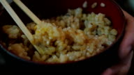 Eat rice with chopsticks. Slow motion. video