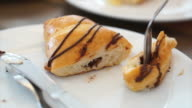 Eating chocolate croissant fresh bake in bakery cafe video