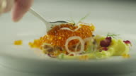 Eating Garnished Red Salmon Caviar with Spoon in Luxury Restaurant video