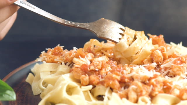 Eating plate of traditional Italian pasta . video