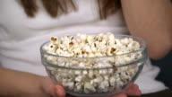 Eating Popcorn, Close up to Popcorn Bowl video