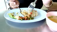 Eating rice steamed with chicken soup in Bangkok Thailand, Hainanese Chicken Rice video