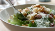 Eating salad with cream souce video