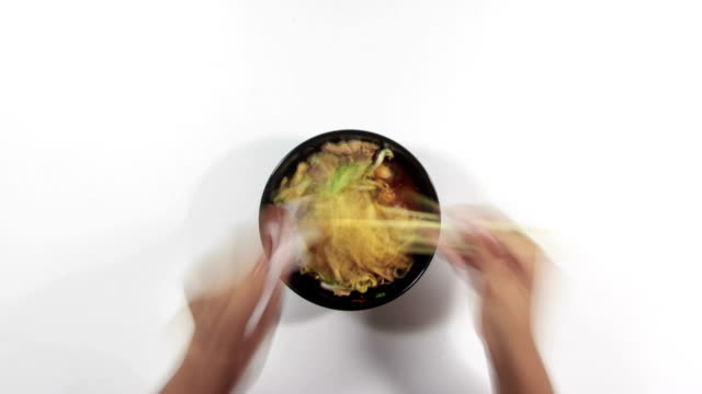 eating spicy asian pork soup with noodle timelapse video
