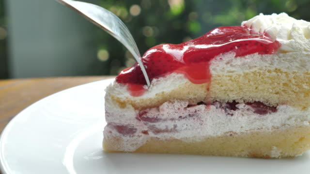 Eating Strawberries cake , Slow motion video