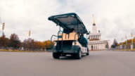 Eco-friendly electric vehicle is ride on the road and delivers people video