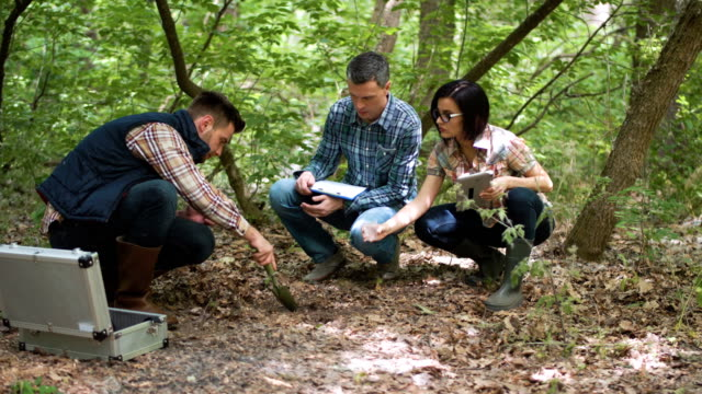 Ecologists taking sample of earth video