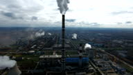 Ecology pollution. Industrial factory pollutes the environment blowing smoke from pipes video