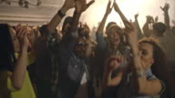 Ecstatic audience dancing at concert video