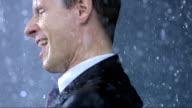 Ecstatic Businessman In The Rain (Super Slow Motion) video