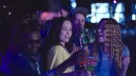 Ecstatic friends dancing in night cub video