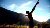 Ecstatic sportsman enjoying a morning run in slow motion video