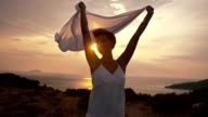 SLO MO Ecstatic woman holding white shawl in the wind video