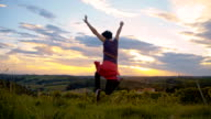 SLO MO Ecstatic Woman jumping video