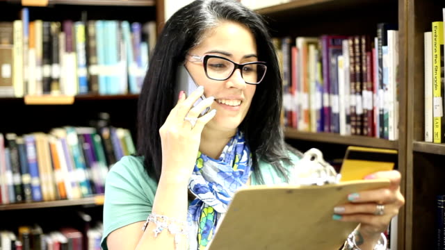 Education-Defocused library shelves filled with books. video