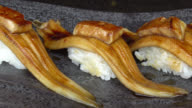 Eel fish sushi with foie gras on top video