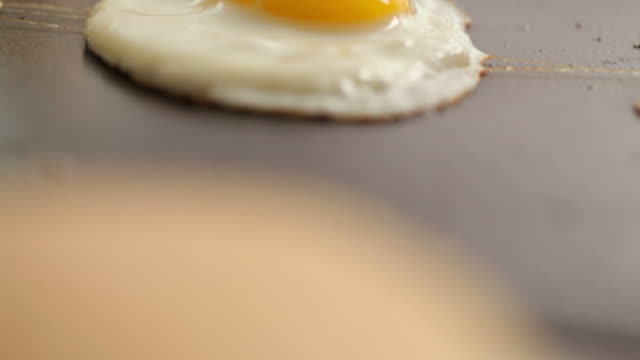 Egg cooking, closeup video