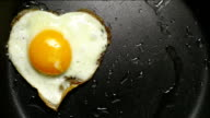 Egg in frying pan. Form of heart. video