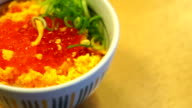 Egg salmon on top of rice bowl video