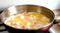 Eggs and sausage in a frying pan video