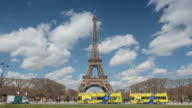 Eiffel Tower with Tourist in Summer, Paris, beautiful sky, Zoom out video