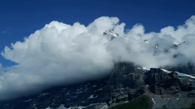 Eiger North Face - clouds swirl over the mountain video