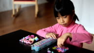 Eight Year Old Girl Makes Bracelet On Her Loom video