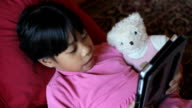 Eight Year Old Girl Reads Story To Teddy Bear video