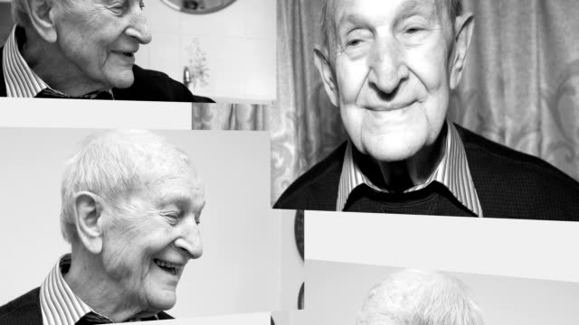 Eighty-eight year old man in his house smiling greyscale video