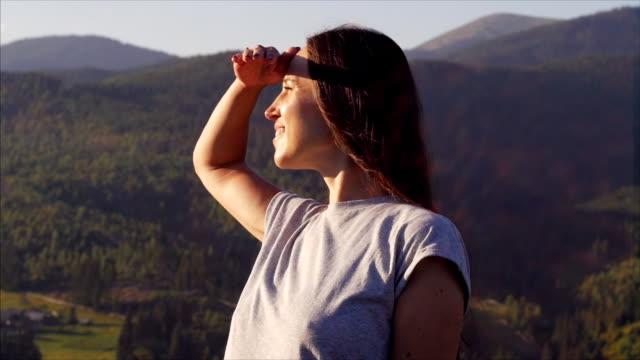 Elated woman enjoying sunset in mountains video