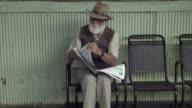 Elder Man With Newspaper video
